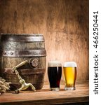 Small photo of Glasses of beer and ale barrel on the wooden table. Craft brewery.
