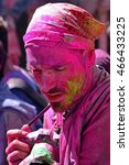 Small photo of MATHURA ,INDIA : MARCH 23, 2016 : Tourist shooting people during celebration of Holi festval in Mathura,India. A traditional Spring festival also known as festival of colours.