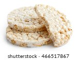 Pile of two and half puffed rice cakes isolated on white.