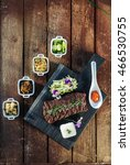 Small photo of Korean BBQ with full side dishes on wooden background