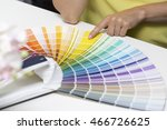 woman choosing paint color from