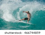a male surfer executes a... | Shutterstock . vector #466744859