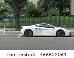 White Exotic Car Parked On A...
