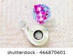 Small photo of Top view of Coffee, a cup of coffee or The long live coffee ,tasteless and unpalatable, water and orchid on blue ceramic bowl. Selective focus
