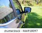 brown modern car on green field | Shutterstock . vector #466918097