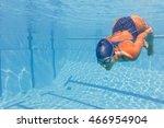 young woman swimming underwater | Shutterstock . vector #466954904