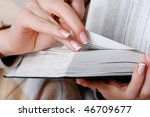 hands of a young girl reading a ... | Shutterstock . vector #46709677