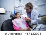 dentist showing model teeth to... | Shutterstock . vector #467132075
