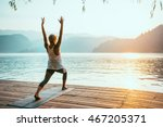 beautiful woman practicing yoga ... | Shutterstock . vector #467205371