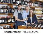 Salesman Holding Wine Bottle...