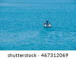 Couple Riding Pedal Boat On A...