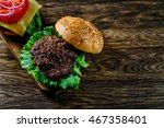 a hamburger with fresh tomatoes ...