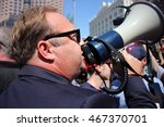 Small photo of Cleveland, OH July 19, 2016: Republican National Convention - Conservative figure, Alex Jones, uses a megaphone to voice his opinion as he increases the level of tension between protesters