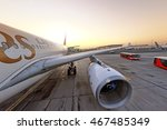 Small photo of DUBAI, UAE - CIRCA NOVEMBER, 2009: Emirates airlines Airbus industries Airbus A330 widebody twin engine passenger airplane arrived to Dubai International airport sunrise panoramic detail exterior view
