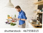 young man chopping vegetables... | Shutterstock . vector #467558315