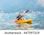Mature Man Kayaking On The Sea