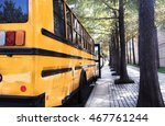 Empty school buses parked next...