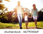 family taking a walk in nature... | Shutterstock . vector #467954069