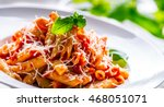 pasta penne with tomato... | Shutterstock . vector #468051071