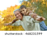 grandfather and grandson in park | Shutterstock . vector #468231599