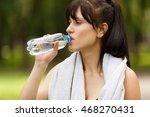 sporty brunette girl drinking... | Shutterstock . vector #468270431
