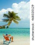man relaxing on beach  ocean... | Shutterstock . vector #468320129