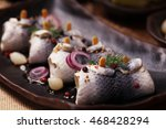 Stock photo rolled herring in vinegar served with onions and pickles perfect for vodka 468428294