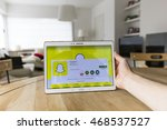 Small photo of LENDELEDE, BELGIUM - JUNE 18TH 2016:a hand holding a Samsung Galaxy Tab S which displays the installation screen of the Snapchat app.An unaltered,illustrative editorial image on an interior background