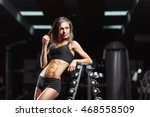 fitness woman posing in the gym.... | Shutterstock . vector #468558509