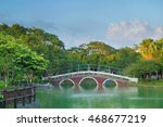 the red arch bridge with green... | Shutterstock . vector #468677219