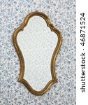 Golden Mirror Frame on Wall with Victorian Wallpaper - stock photo