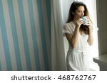 woman drinking coffee by the... | Shutterstock . vector #468762767