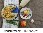 Stock photo vegetable cake with zucchini tomatoes cheese onions and garlic served on plate against rustic 468766091