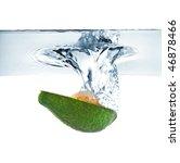 avocado falling into water - stock photo