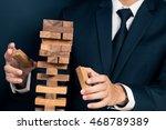 businessman builds a tower | Shutterstock . vector #468789389