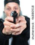 young woman aims a gun   Shutterstock . vector #46880518