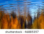 Autumn Trees Reflected In Water