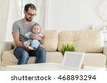 dad playing with baby | Shutterstock . vector #468893294