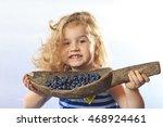 little girl holding a bucket of ... | Shutterstock . vector #468924461