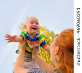 baby with down syndrome is... | Shutterstock . vector #469060391