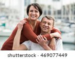 positive adult couple hugging... | Shutterstock . vector #469077449