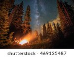 family stargazing by a campfire ... | Shutterstock . vector #469135487