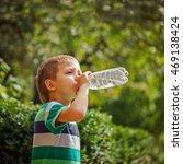 cute little boy drinking... | Shutterstock . vector #469138424