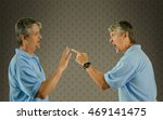 a man is arguing with himself... | Shutterstock . vector #469141475
