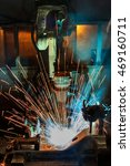 robot welding automotive part   | Shutterstock . vector #469160711