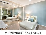 Stock photo modern and classic bedroom walls are light blue which is illuminated in lights of the table lamp 469173821