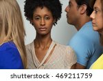 woman standing alone in a crowd. | Shutterstock . vector #469211759