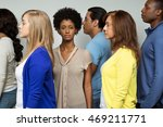 woman standing alone in a crowd. | Shutterstock . vector #469211771