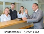 hotel staff following... | Shutterstock . vector #469241165