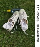 white sneakers at garss | Shutterstock . vector #469334261